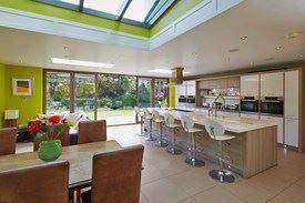 Modern white kitchen in open plan area with open Origin 6 door set